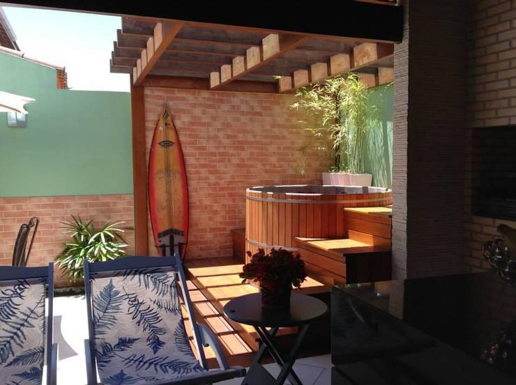 Projeto Churrasqueira e Jaccuzi: Terraços  por Ana de Angelo Designer de Interiores,Moderno