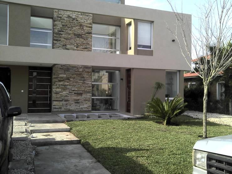 CASA C Casas modernas: Ideas, imágenes y decoración de Desarrollos Proyecta Moderno Vidrio