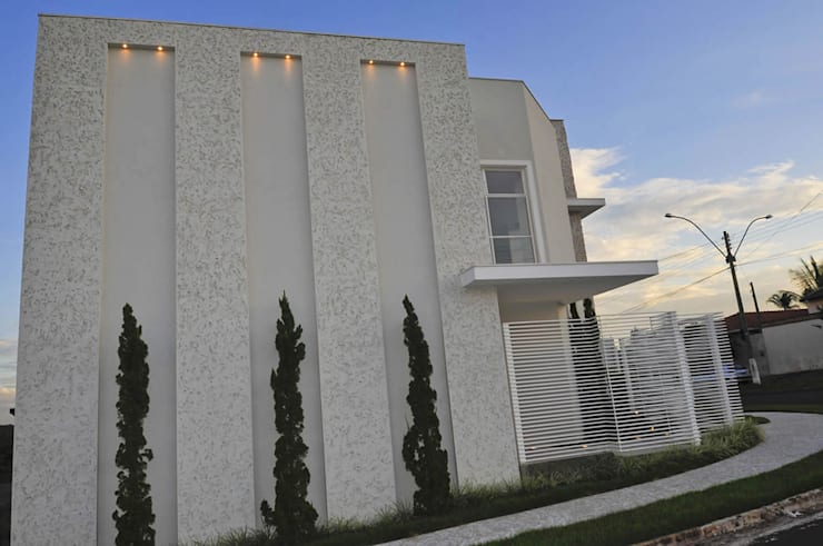 Casa 2011: Casas  por Luciana Rogério e Luís Alfredo Marques Arquitetura e Design de Interiores