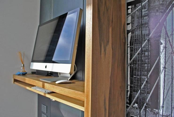Depto DLH: Estudios y oficinas de estilo  por T + T Arquitectos,