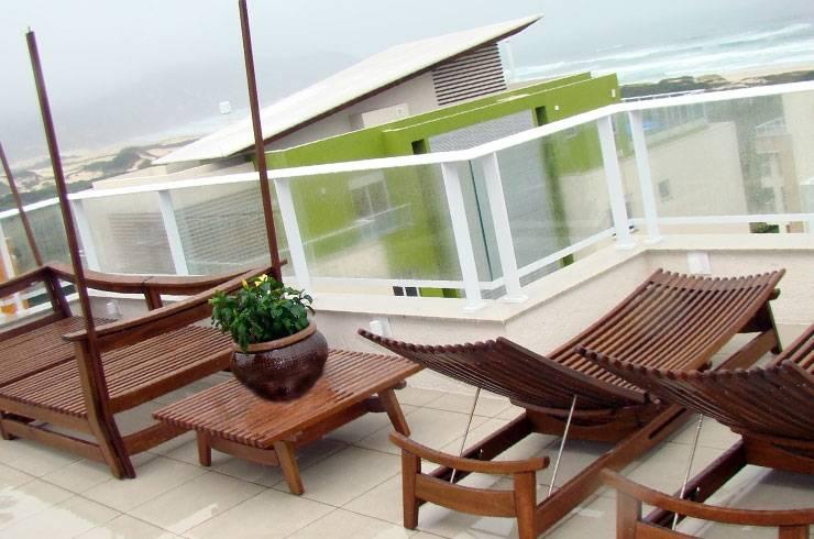 Apartamento JAG: Terraços  por Ana Padilha Arquitetura,Moderno