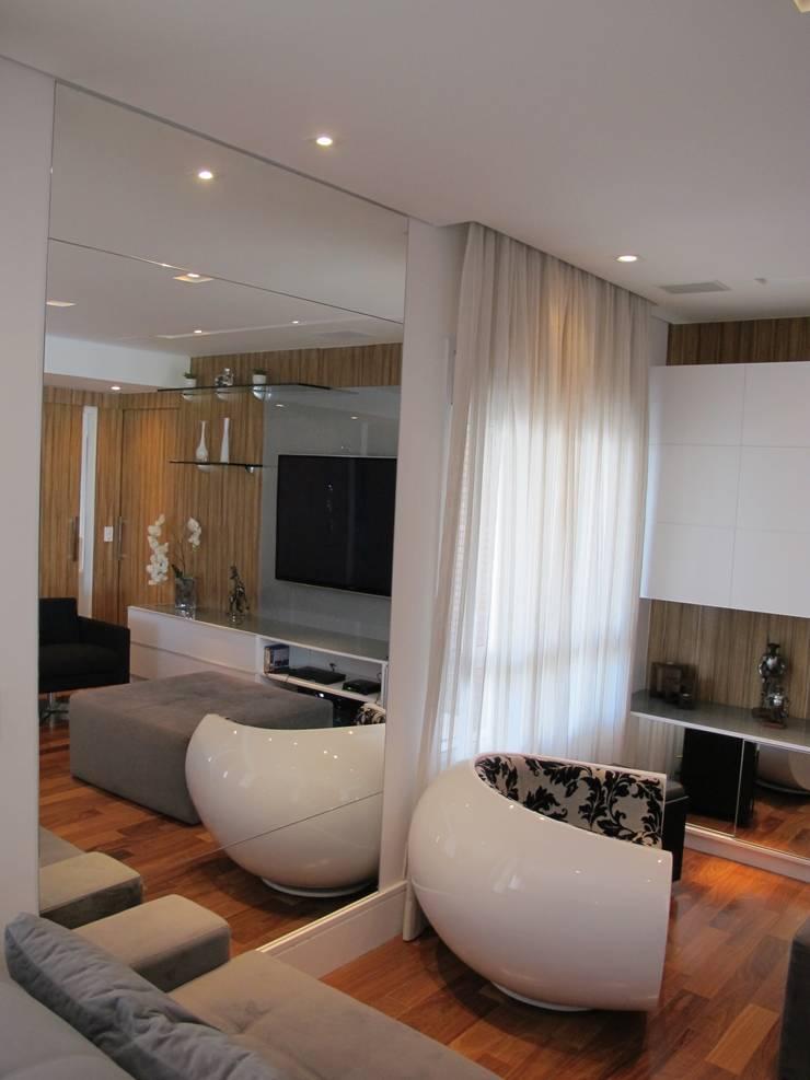 Residencia / Apartamento: Salas de estar  por Andrea Vasconcelos Arquitetura e Design