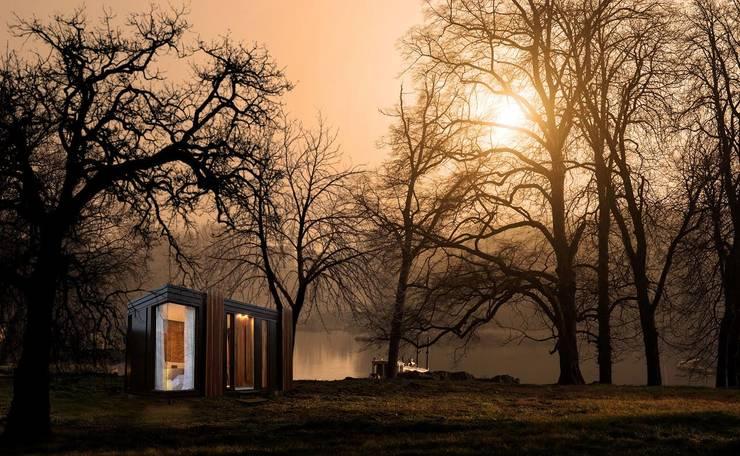 Proyecto Nomad: Casas de estilo  por T + T Arquitectos