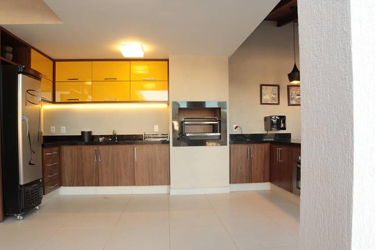 Área de lazer: Cozinhas  por StudioM4 Arquitetura,