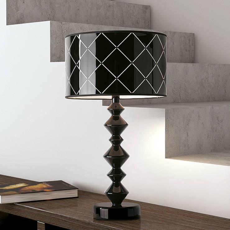 PAULO COELHO lamps: Casa  por LUZZA by AIPI - Portuguese Lighting Association