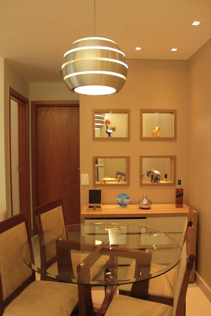 Projeto de interiores de apartamento: Sala de jantar  por StudioM4 Arquitetura,