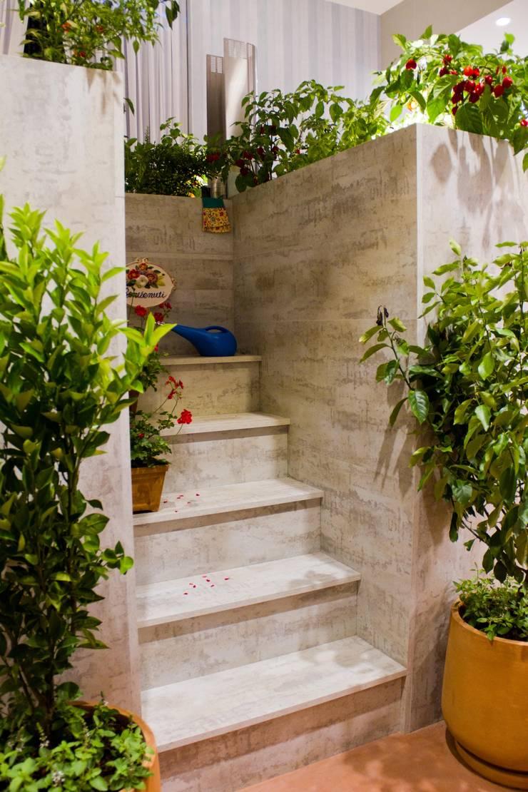 CASA COR 2012 – COZINHA GOURMET: Jardins de inverno  por AMMA PROJETOS