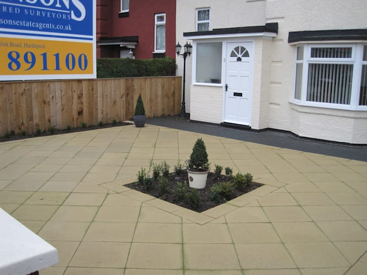 Small front garden with contemporary paving reversed:   by Mike Bradley Garden Design