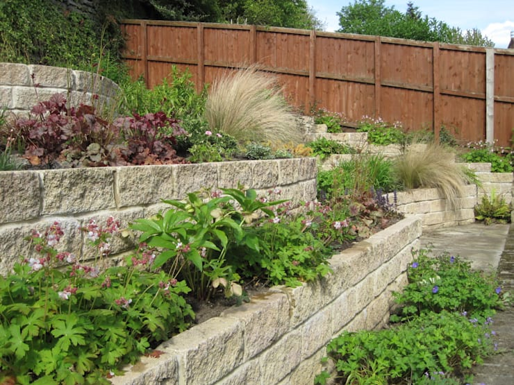 Completed terraces with planting:   by Mike Bradley Garden Design