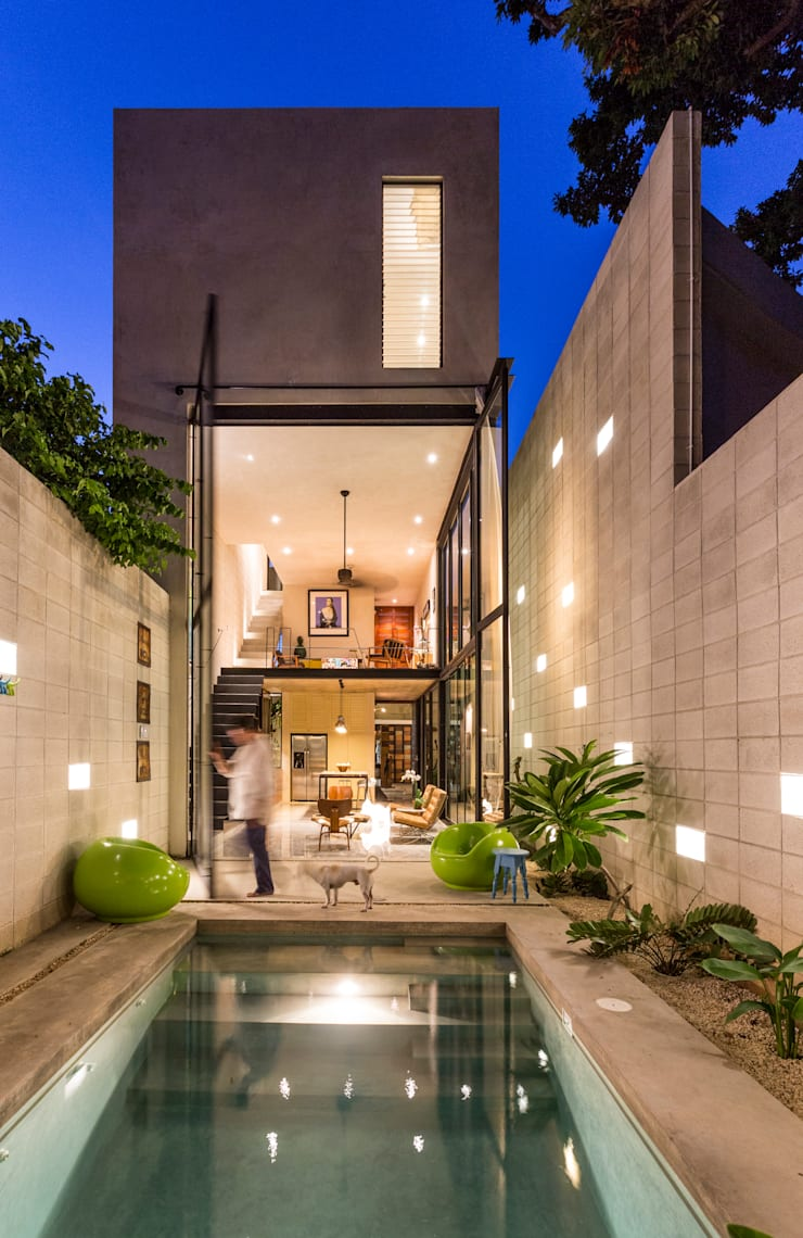 Fachada Posterior: Casas de estilo  por Taller Estilo Arquitectura