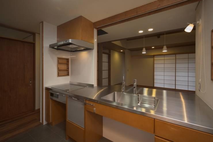 豊浦町の家: AMI ENVIRONMENT DESIGN/アミ環境デザインが手掛けたキッチンです。