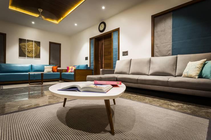 Chandresh bhai interiors:  Living room by Vipul Patel Architects
