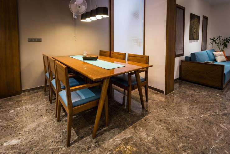 Chandresh bhai interiors: modern Dining room by Vipul Patel Architects