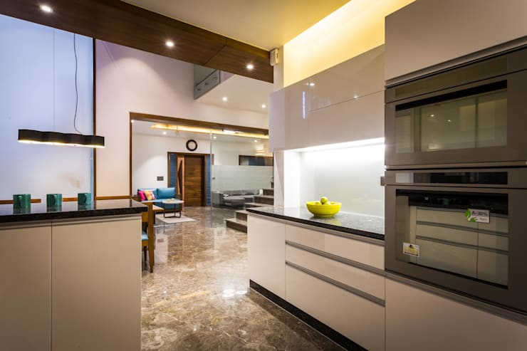 Chandresh bhai interiors: modern Kitchen by Vipul Patel Architects