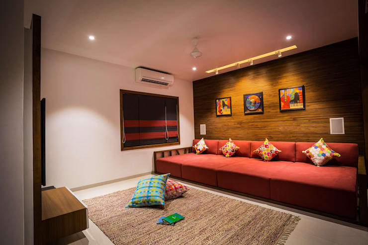 Chandresh bhai interiors:  Living room by Vipul Patel Architects