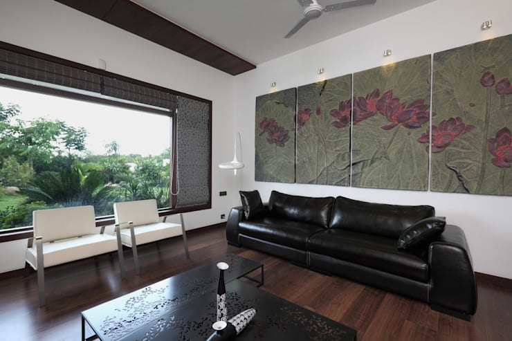 Dual house images:  Living room by Vipul Patel Architects