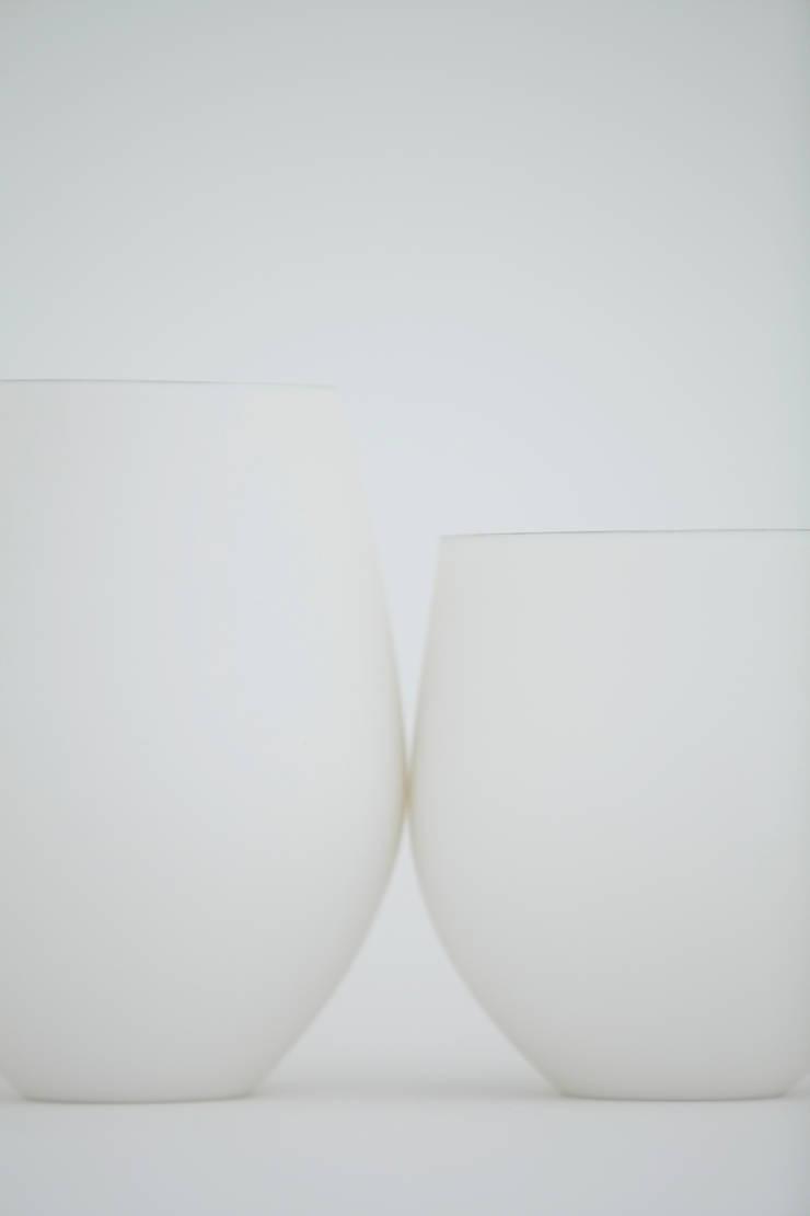 タマゴカップ: RYOTA AOKI POTTERYが手掛けたダイニングルームです。