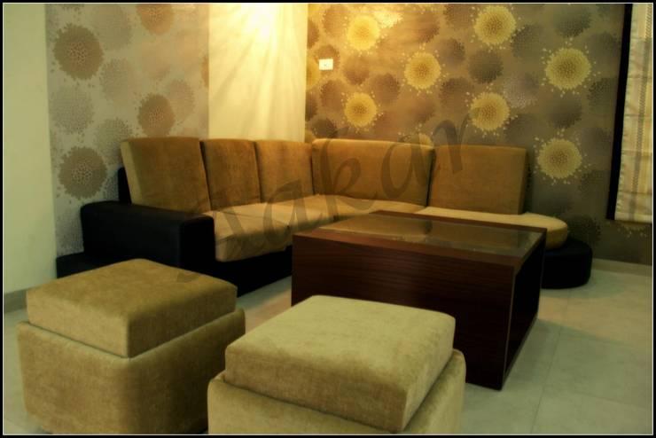 Interior Designs: modern Living room by ES Designs
