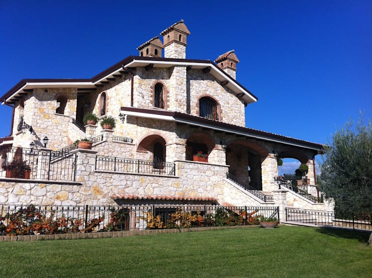 Casas de estilo rural por Arch. FLAVIA SCANZANI