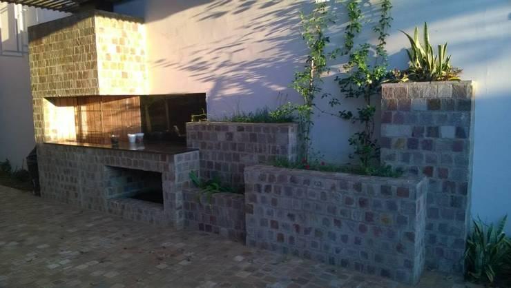 Casa PB: Jardines de estilo  por LS+M
