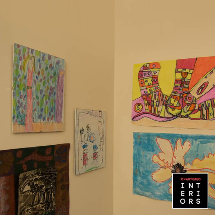 Kids Room Designs:  Nursery/kid's room by Chartered Interiors