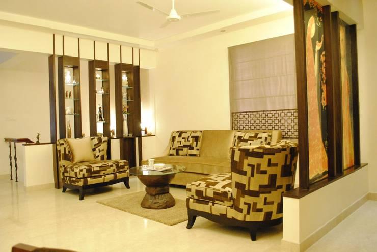 Duplex Apartment: modern Living room by Construction Associates