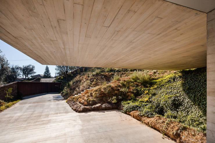 Refúgio na Montaria: Jardins  por Carvalho Araújo