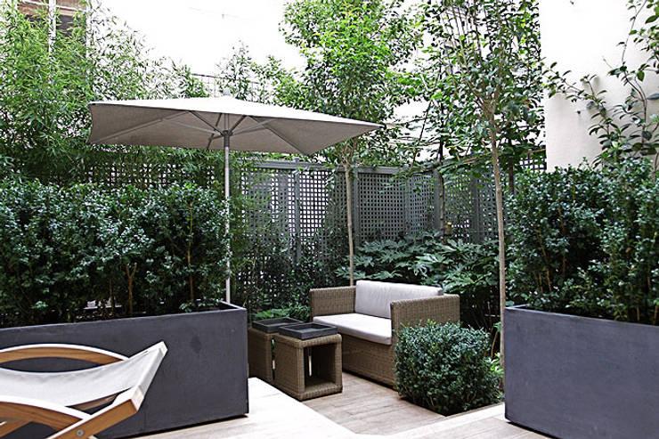 Réaménagement d'un Appartement Parisien : Jardin d'hiver de style  par Agence Inside DECO