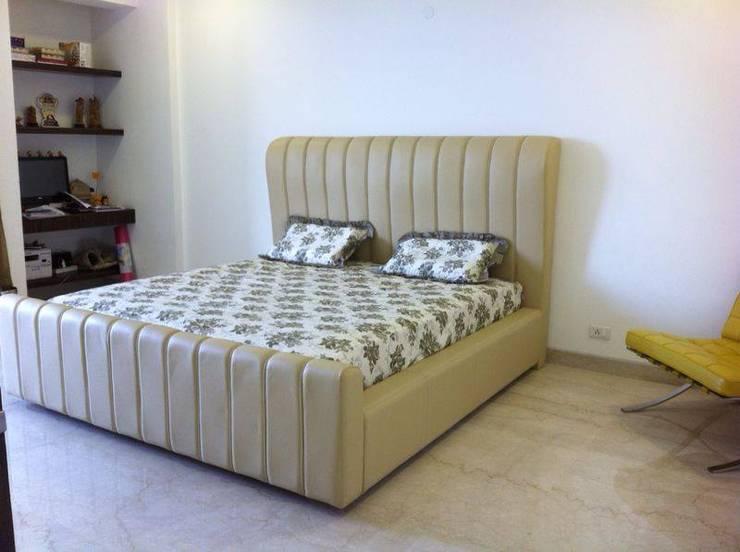 Dormitorios de estilo  de Tasteful living, Moderno