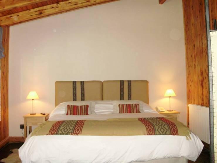 Dormitorios ★★★★★: Hoteles de estilo  por INTEGRAR DISEÑO,Moderno