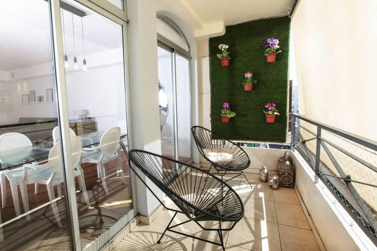 Obra Cabello Balcones y terrazas modernos: Ideas, imágenes y decoración de Arq. Jazmin Zang Moderno