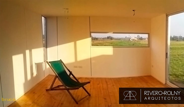 Salas / recibidores de estilo  por riverorolnyarquitectos, Industrial