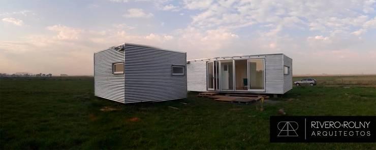 VIVIENDA MS: Casas de estilo industrial por riverorolnyarquitectos