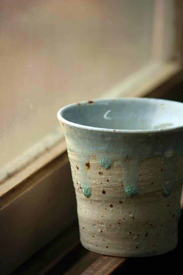 みかん釉薬フリーカップ: 陶芸工房ゆうゆうが手掛けたキッチンです。