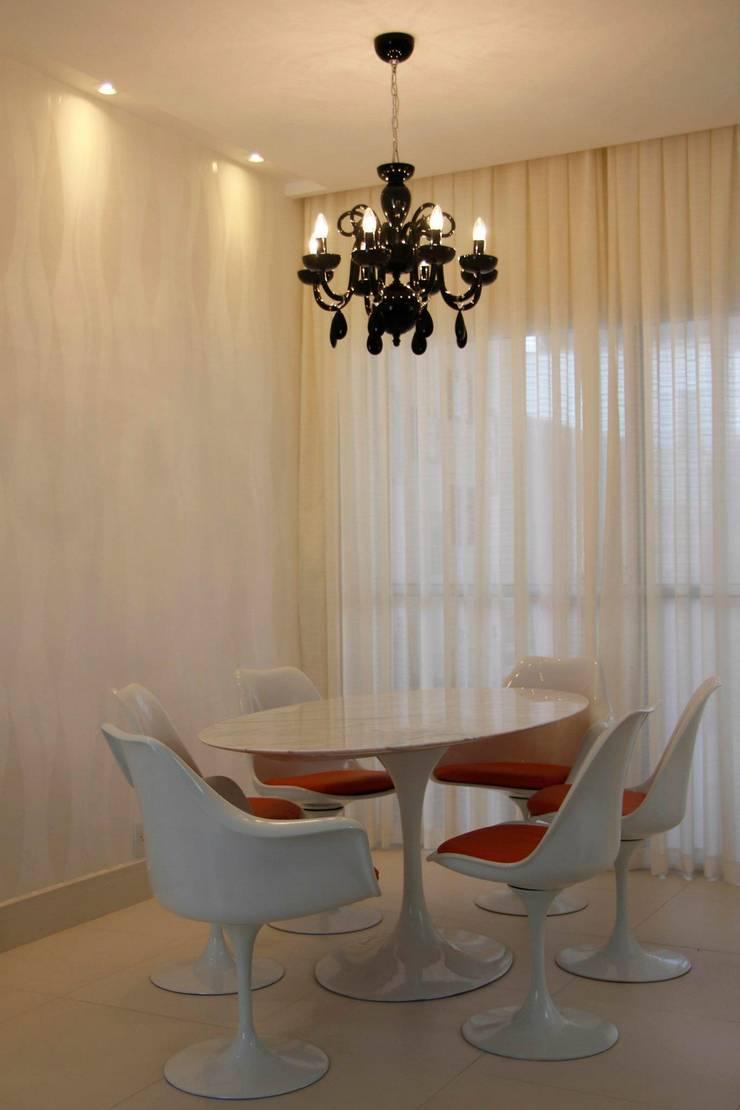Sala de Jantar: Sala de jantar  por Carol Abumrad Arquitetura e Interiores