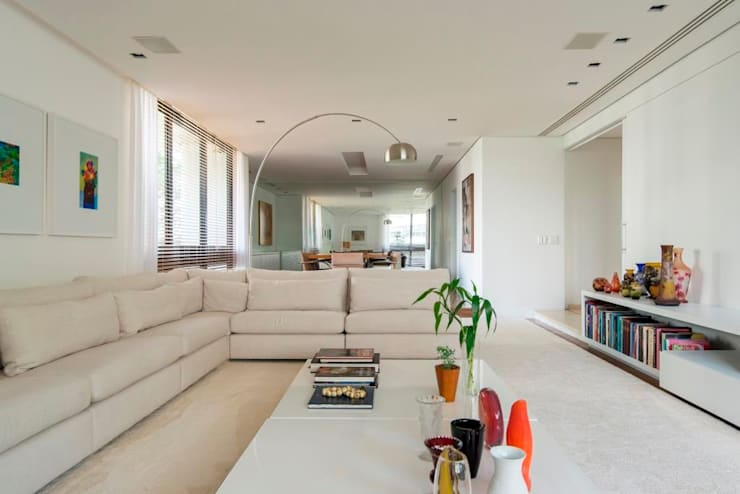 sala de estar: Salas de jantar  por RASSINI arquitetura