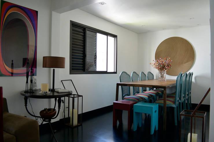 Reforma – Rua Jupter: Salas de jantar  por MEM Arquitetura