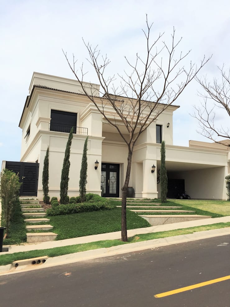 Residencia Lemos – Quinta Golfe: Casas  por FERNANDO ROMA . estudioROMA
