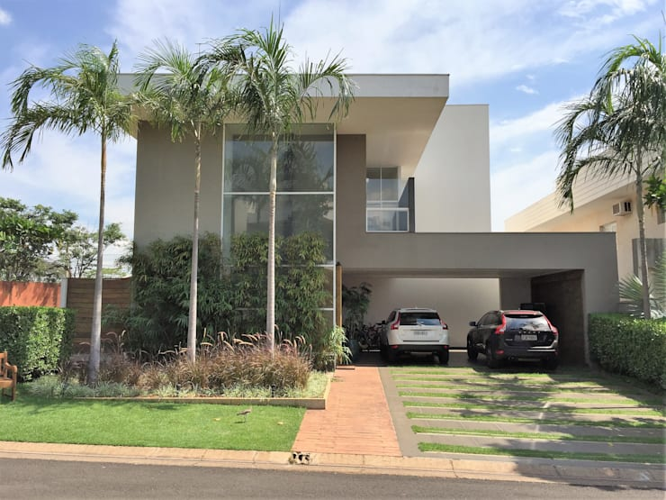 Residencia Biscaro - Condominio Harmonia: Casas  por FERNANDO ROMA . estudioROMA