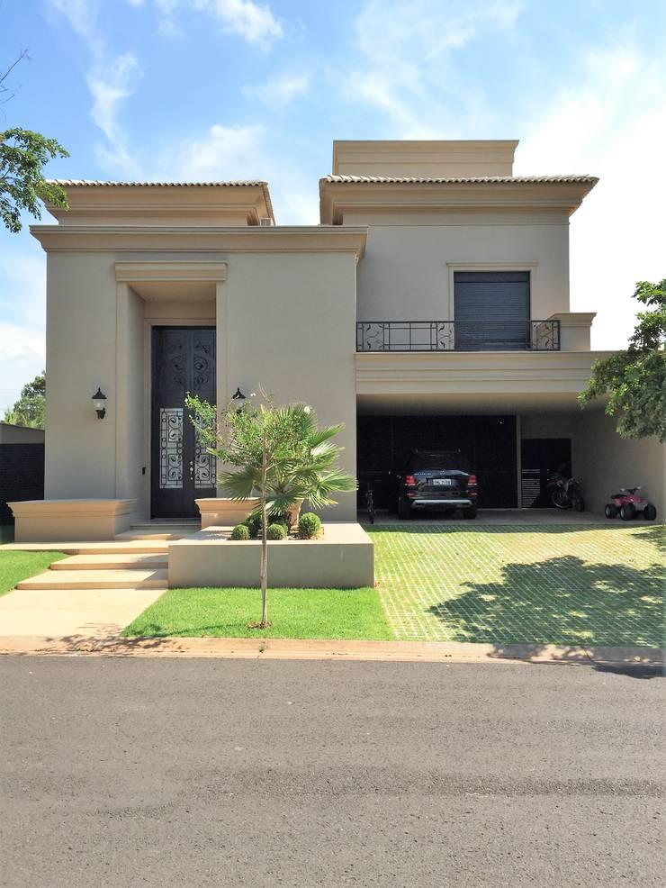 Residencia Condominio Harmonia: Casas  por FERNANDO ROMA . estudioROMA