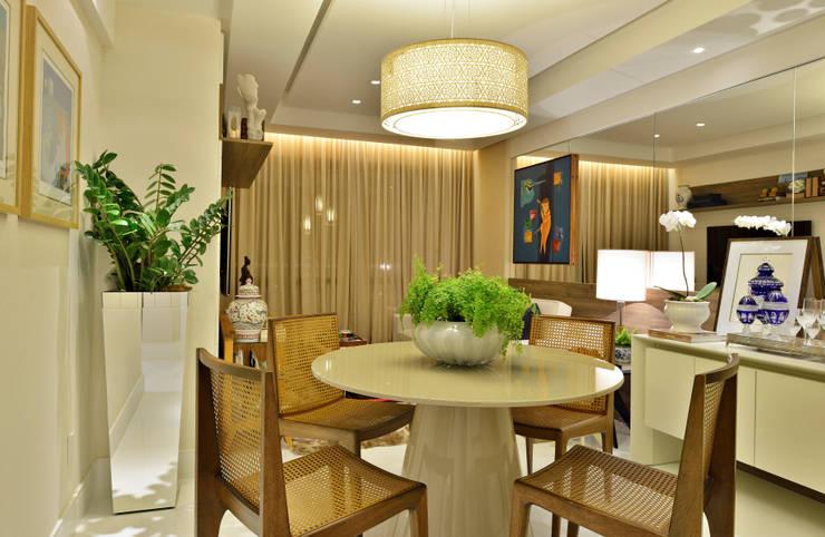 Apartamento FL: Salas de jantar  por Bastos & Duarte