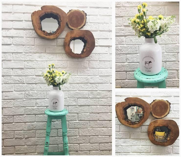 rodajas y madera: Hogar de estilo  por Sepia interiores