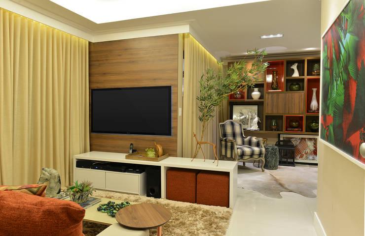 Apartamento TJ: Salas de estar ecléticas por Bastos & Duarte