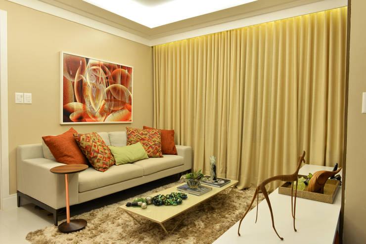 Apartamento TJ: Salas de estar  por Bastos & Duarte