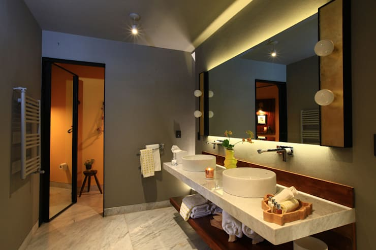 Baños de estilo  por Germán Velasco Arquitectos