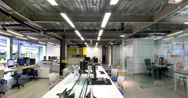 Oficinas BNI: Estudios y oficinas de estilo  por DIN Interiorismo