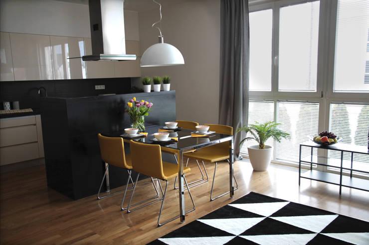 Salon/jadalnia: styl , w kategorii Jadalnia zaprojektowany przez Mhomestudio