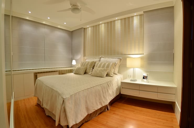 Dormitório casal: Quarto  por Stúdio Márcio Verza