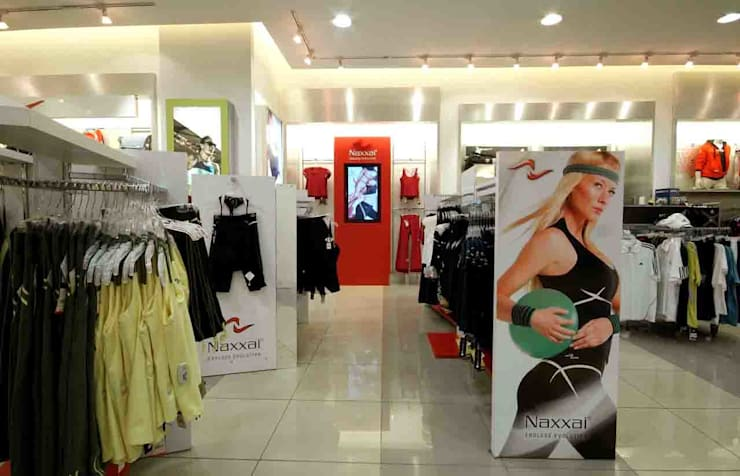 Naxxai: Oficinas y tiendas de estilo  por DIN Interiorismo