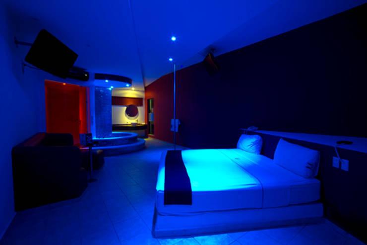 Hotel Istmo: Recámaras de estilo  por DIN Interiorismo